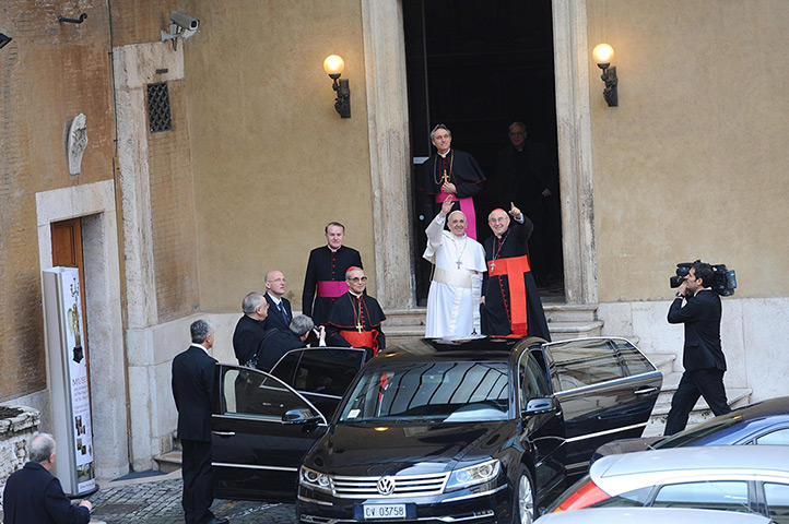 Pope Francis waves as he leaves Santa Maria Maggiore Basilica